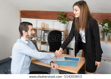Business people shaking hands, finishing up a business meeting