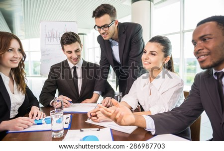 Business people sitting in meeting room at office and working.