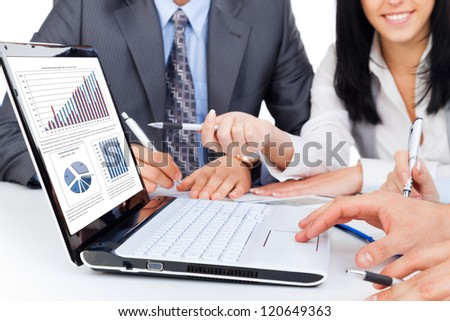 business people team work group during conference report discussing financial diagram, charts, on laptop screen businesspeople meeting sitting at desk office pointing hand finger at graph