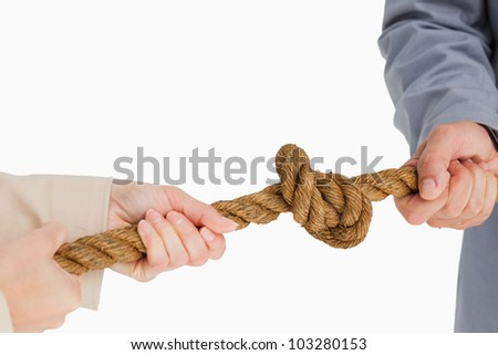 Business people tightening a knot against white background
