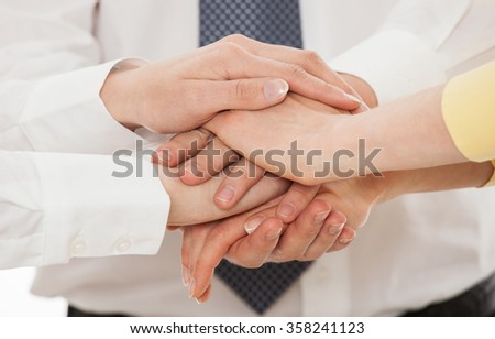 Business people uniting their hands - gesture of a union, white background