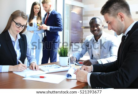 Business people working on new project at modern office