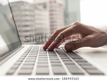 Business person using a laptop computer.