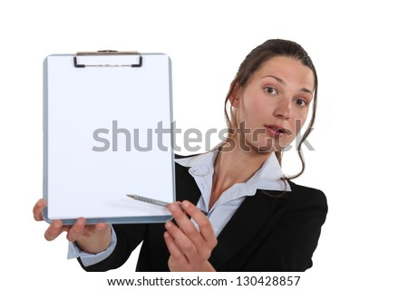 Business professional pointing to a clipboard
