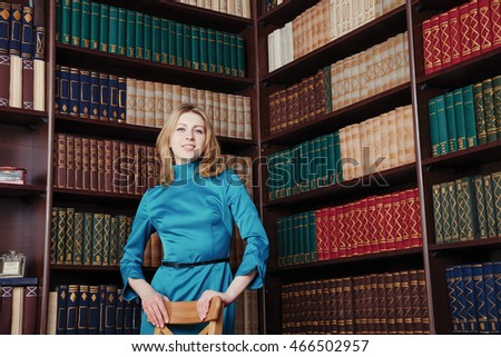 Business smart lawyer lady near bookcase