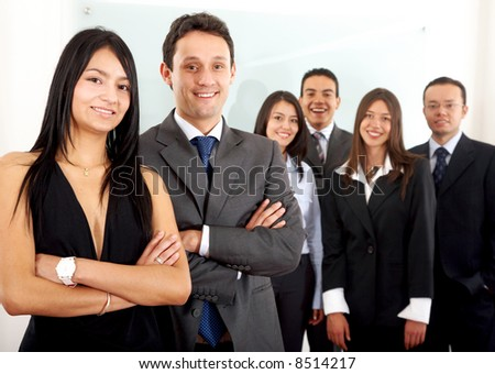 Business team in an office with a businesswoman and a businessman leading