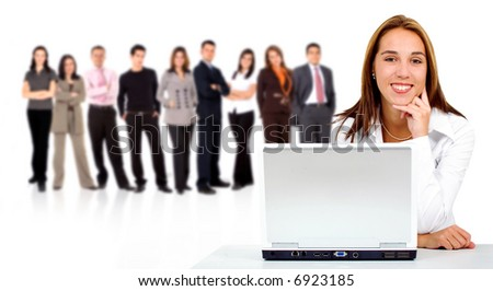 business team in the background with a businesswoman in an office laptop computer at the front - isolated over a white background