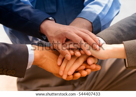 Business team joining hands together,teamwork concept.
