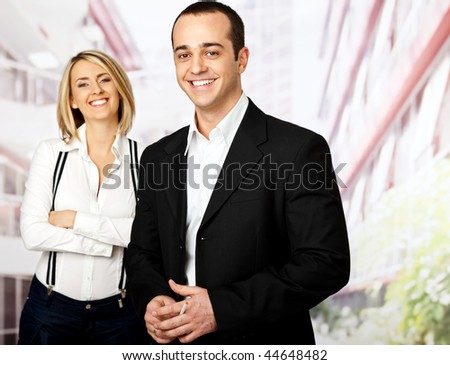business team of two smiling male on focus