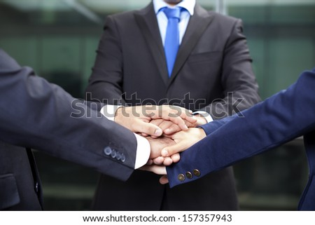 Business team showing union with their hands together forming a pile