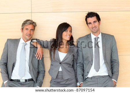 Business team standing in hall