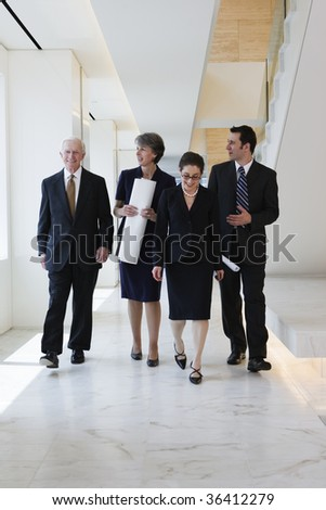 Business team walking to a planning meeting
