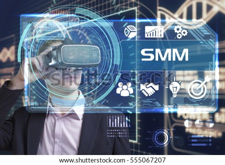 Business, Technology, Internet and network concept. Young businessman working in virtual reality glasses sees the inscription: SMM