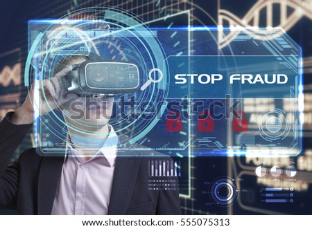 Business, Technology, Internet and network concept. Young businessman working in virtual reality glasses sees the inscription: stop fraud
