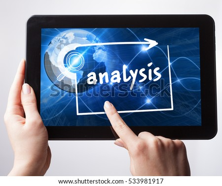 Business, Technology, Internet and network concept. Young businessman, working on the tablet , select on the virtual display: analysis