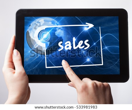 Business, Technology, Internet and network concept. Young businessman, working on the tablet , select on the virtual display: Sales