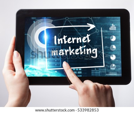 Business, Technology, Internet and network concept. Young businessman, working on the tablet , select on the virtual display: internet marketing