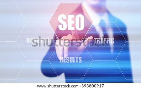 business, technology, internet and virtual reality concept - businessman pressing seo button on virtual screens with hexagons and transparent honeycomb