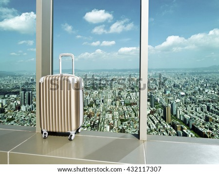 business travel,suitcase at window in airport against city in bird view