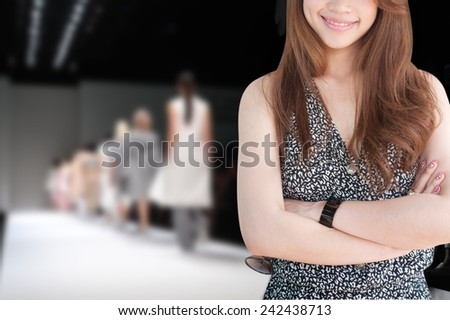 business woman has fashion show background