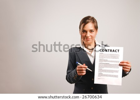 Business woman holding a printed contract
