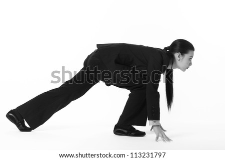 business woman in a position to start a running race