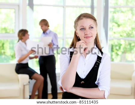 business woman in office and collegues on background