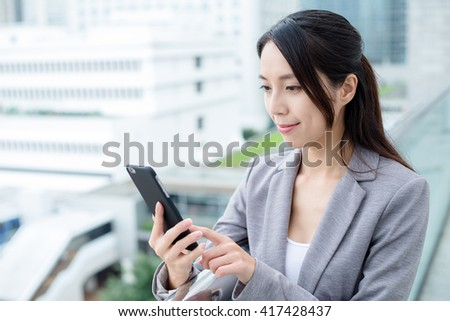Business woman look at the mobile phone