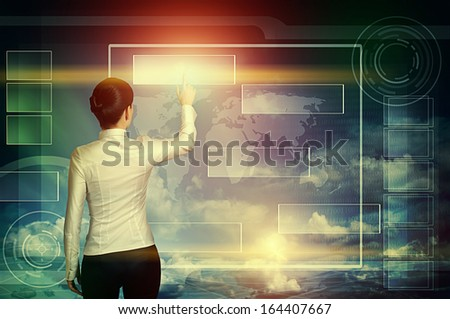 business woman push virtual icon in multicolored web interface over blue cloudy sky