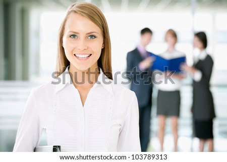 Business woman standing in front of her colleagues