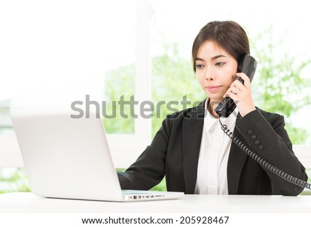 Business woman talking cellphone