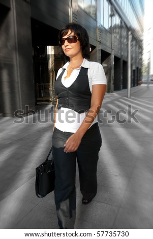 Business woman walking down the street