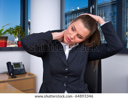 business woman with head and neck pain in office
