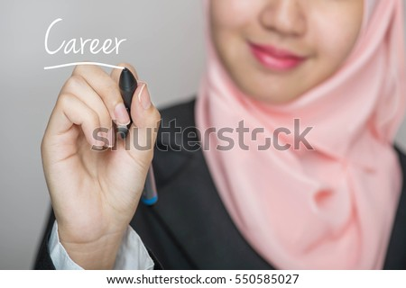 Business woman writing text : Career over gray background