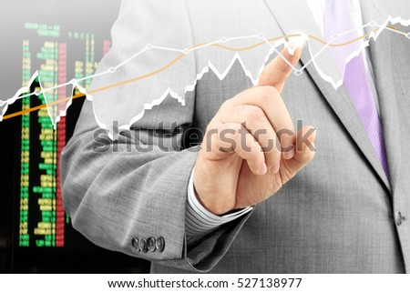 Businessman analyzing financial chart