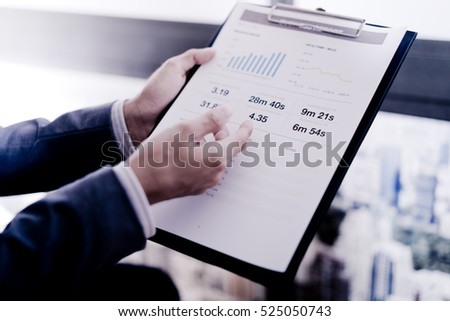 Businessman analyzing investment charts. Financial Report Revenue Statistical Accounting Concept