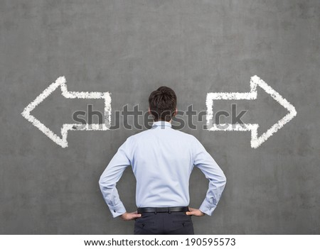 Businessman and arrows 'left or right'