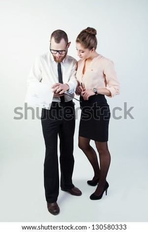 businessman and businesswoman treated paper