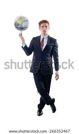 Businessman, balancing the globe on his forefinger.