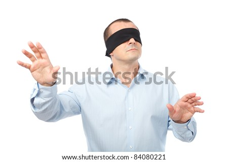 Businessman blindfolded stretching his arms out, isolated on white background