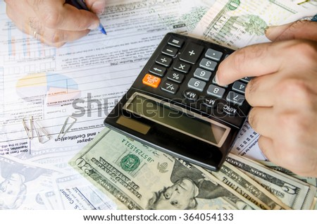 Businessman calculating and checking tax