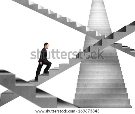 Businessman climbing on concrete stair maze isolated in white background