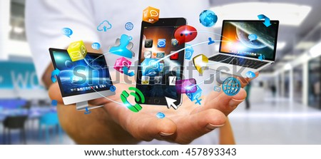 Businessman connecting colorful tech devices and icons applications '3D rendering'