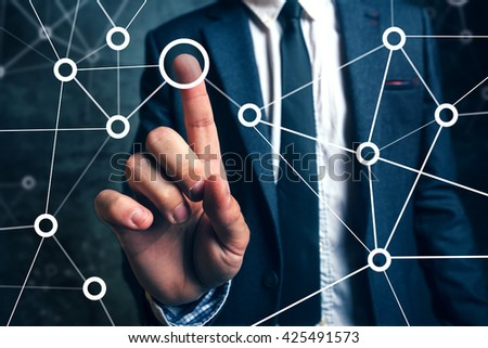 Businessman connecting the dots in business project management, social networking or teamwork organization.