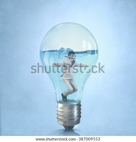 Businessman diver in bulb