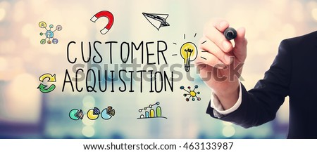 Businessman drawing Customer Acquisition concept on blurred abstract background