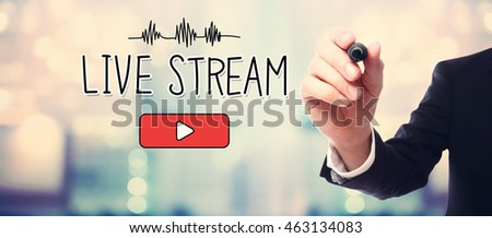 Businessman drawing Live Stream concept on blurred abstract background