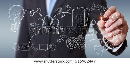 Businessman drawing manuscript project presentation with a pen on blurred background