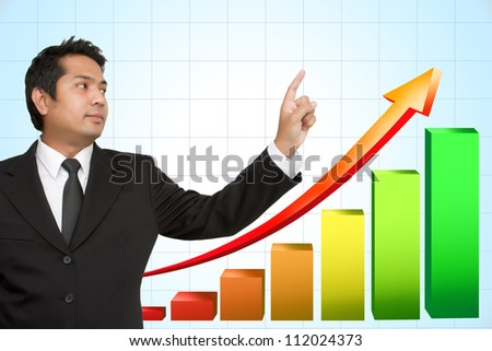 Businessman hand pointing arrows and graphs