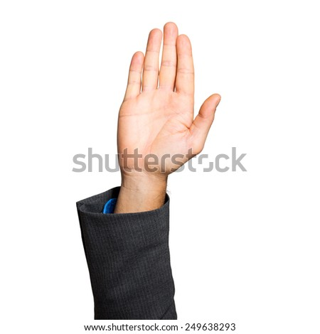 Businessman hand raised isolated on white